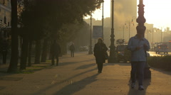 Beautiful view of people walking on a street at sunset in Trieste - stock footage
