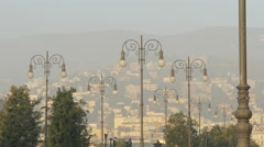 Beautiful cityscape seen through vintage lamp posts in Trieste Stock Footage