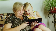 Grandmother and granddaughter playing together - stock footage