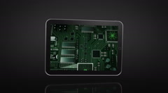 Spinning Tablet animation. Black background. Circuit board video on the screen. - stock footage