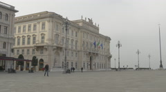People in Piazza Unita near Palazzo del Lloyd in Trieste - stock footage