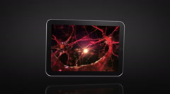 Spinning Tablet Animation. Black background. Nerve cell videos on the display. - stock footage