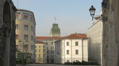Clock tower of the city hall seen from Saint Silvestro church in Trieste - stock footage