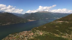 Gorgeous mountains on lake maggiore aerial shot Stock Footage