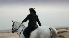 Arab Horsemen on desert in Bahrain Stock Footage