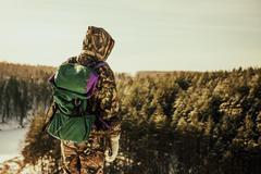 Caucasian hiker standing on hilltop Stock Photos