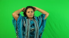 Latina woman being seductive, dancing and then taking off shawl Stock Footage