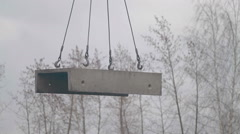 Concrete slabs hang on slings Stock Footage