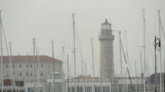 Beautiful view of Lanterna di Trieste and boat masts on a misty day in Trieste Stock Footage