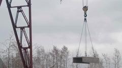 Crane lowers concrete slab Stock Footage