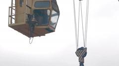 Crane lowers concrete slab construction site Stock Footage