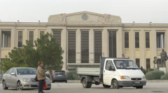Parked cars and a woman in front of Palazzo dei Congressi Trieste Stock Footage