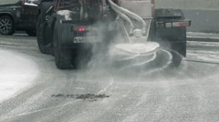 Cleans snowy road, truck deicing a road in winter Stock Footage