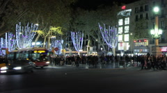 Busy crosswalk at night. Barcelona. Time lapse. Pan. Blurred faces and logos. Stock Footage