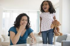 Girl shouting at stressed mother - stock photo