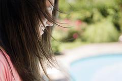 Profile of Caucasian woman outdoors Stock Photos