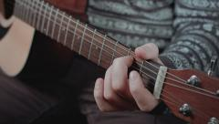 Close up of guitarist hand playing acoustic guitar - stock footage