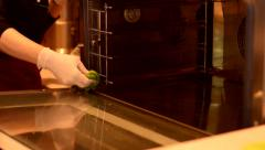 Hand with microfiber cleaning electric oven - stock footage