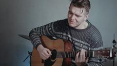 Handsome men, professional guitarist playing acoustic guitar and singing - stock footage