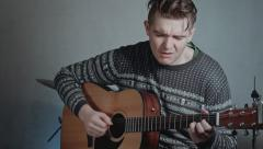 Handsome men, guitarist playing acoustic guitar and singing Stock Footage