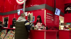 One side of auto service counter inside Canadian tire store Stock Footage