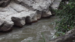Slowmotion of water in mountain river Stock Footage