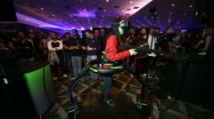 VRLA Expo - Woman in Virtuix Omni VR Treadmill Stock Footage