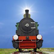 old steam engine locomotive train on beautiful sky background - stock photo