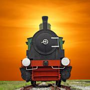 old steam engine locomotive train on beautiful sky background - stock photo