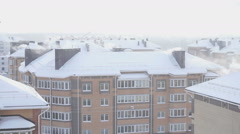 The smoke from the chimneys of a five-story residential home in winter Stock Footage