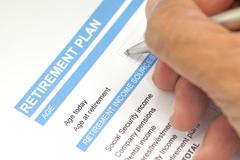 retirement plan document with pen - stock photo