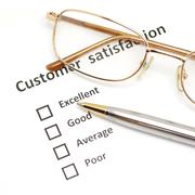 Customer satisfaction survey form with pen and eye glasses Stock Photos