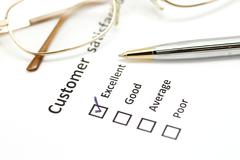 customer satisfaction survey form with pen and eye glasses - stock photo