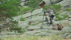 Cameraman in mountains Stock Footage