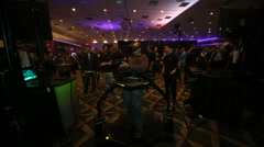 VRLA Expo - Man in Virtuix Omni VR Treadmill Stock Footage