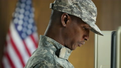Soldier voting in a voting booth Stock Footage