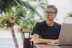 Caucasian man using laptop outdoors Kuvituskuvat