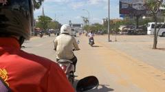 SIEM REAP, CAMBODIA - NOV 2015: Riding motor bike on street Stock Footage