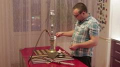 A man smoking a hookah Stock Footage