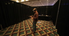 VRLA Expo - Man Using HTC Vive Stock Footage