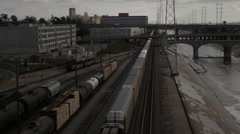 Moving freight train carrying storage containers in downtown Los Angeles Stock Footage