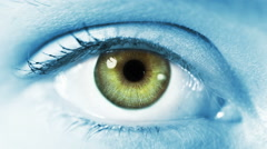 Close-up of a colored eye blinking. Blue and regular skin. Stock Footage