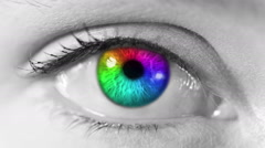 Zoom in from a multicolored human eye to a network animation. Gray skin. - stock footage