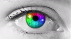 Zoom in from a multicolored human eye to a tunnel animation. Gray skin - stock footage