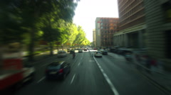 Driving. Time-lapse. Car driving through a big city. Sunny day. Stock Footage