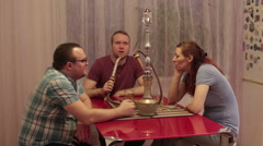 People smoke shisha and talking Stock Footage