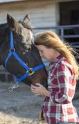 Caucasian woman hugging horse on ranch Stock Photos