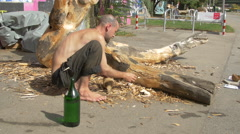 Sculpting wood on the Danube Canal waterfront, Vienna Stock Footage