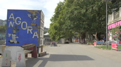 Graffiti and an inscription on wooden box on Donaukanal waterfront in Vienna Stock Footage