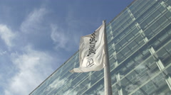 White flag in front of IBM Client Center in Vienna Stock Footage